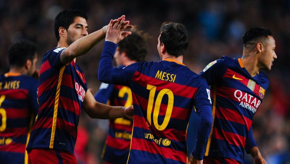 Leo Messi y Luis Suárez celebran un gol ante el Celta